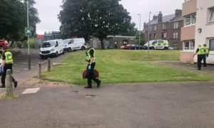 Police raided Ancrum Court in Dundee.