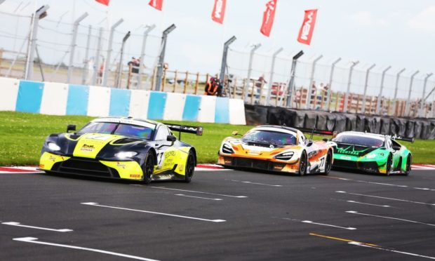 Adam (front) and Mitchell (rear) were involved in a thrilling three-car battle in the closing stages at Donington Park. Supplied by British GT.