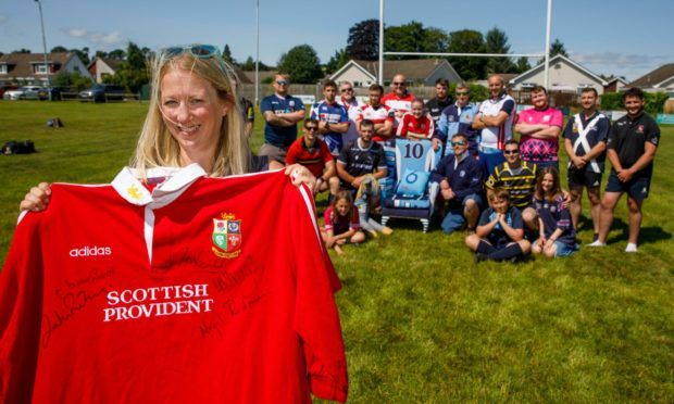 Jayne Lamont with Blairgowrie RFC players.
