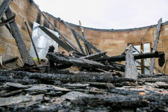 The fire damaged sluice house