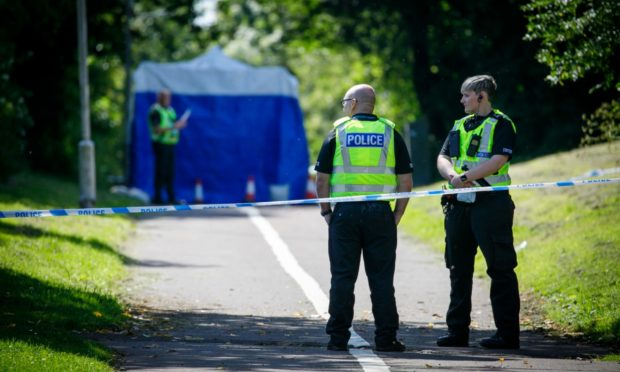 Police officers are investigating the death