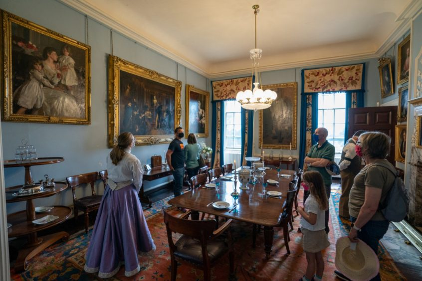 Visitors enjoy a guided tour of the House of Dun.