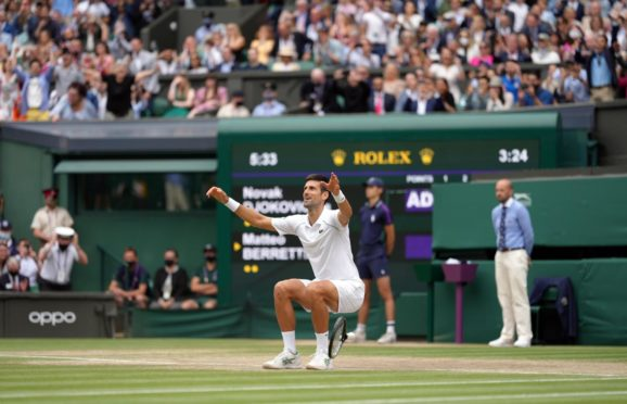 Novak Djokovic celebrates beating Matteo Berrettini to win Wimbledon 2021.