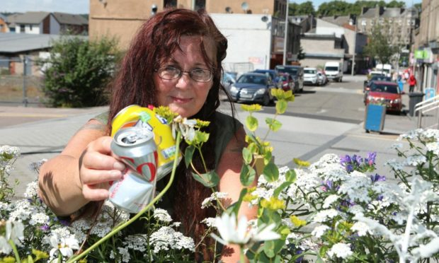 Alison Dreads clearing rubbish from the planters she worked on in Lochee
