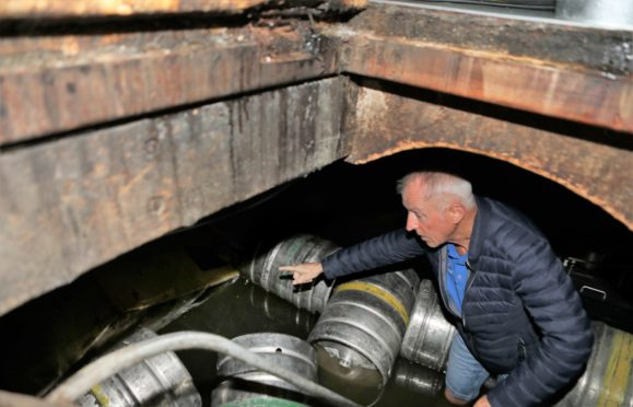 Ronnie Bissell surveys the damage in his cellar