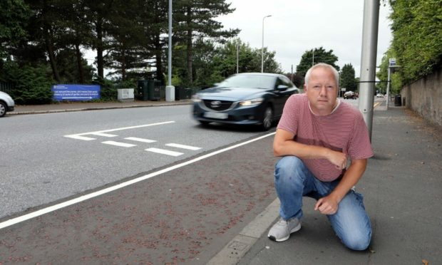 Craig at the new road markings on Perth Road.