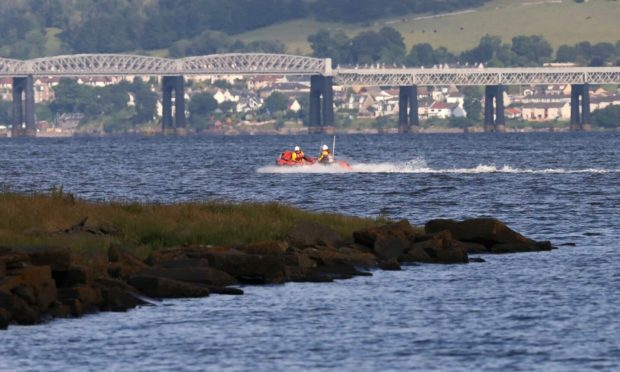 A search is ongoing on the Tay for paddleboarders reported to be in difficulty.