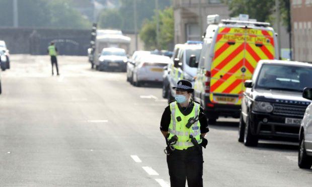 Police activity on Sandeman Street on Tuesday