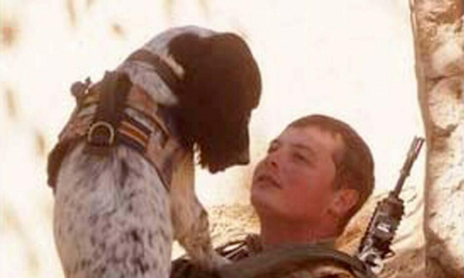 Liam Tasker with military dog Theo
