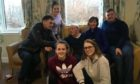 John Angus surrounded by his family inside the Home Farm care home on Skye.