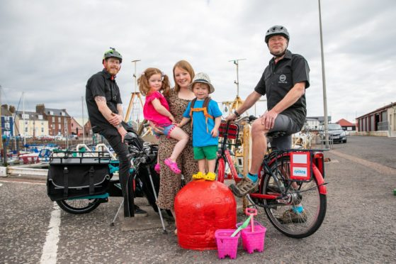 Jason Bennett and Iain Hay of Angus Cycle hub with Nicola Young and her children Ayla, 4, and Jack, 2, at the Arbroath harbour launch of the Visit Angus app. Pic: Kim Cessford / DCT Media.
