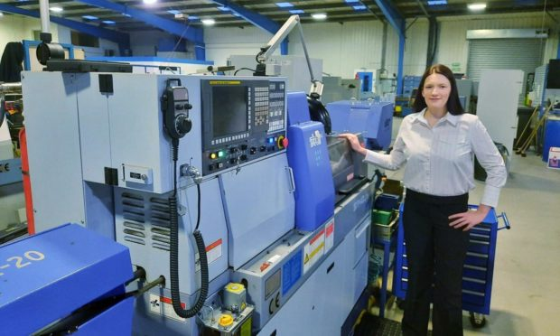 GA Engineering Sliding Head operations director Kerry Devlin with a new lathe.