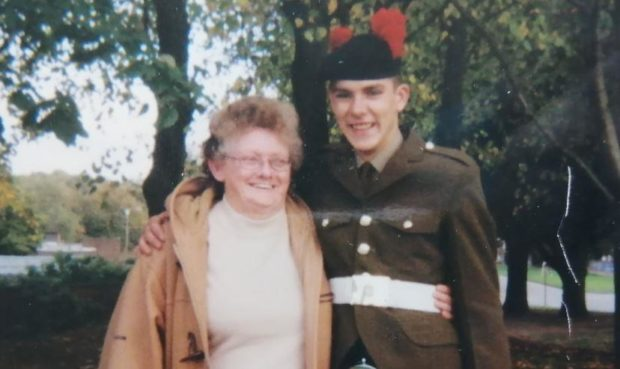 Kevin Elliott in army uniform with his arm round his grandmother Joan Humphreys