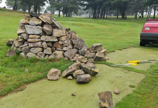 A stone cairn was damaged at Lochgelly Golf Club.