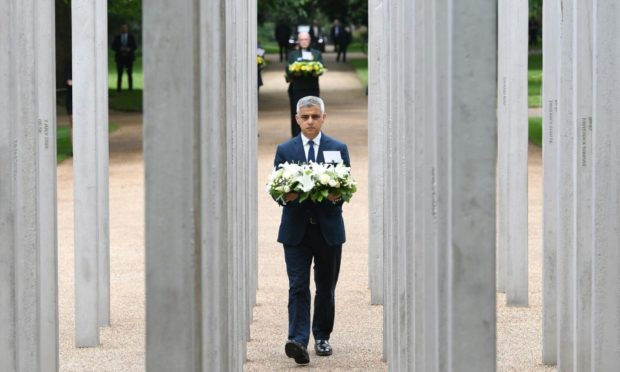 Mayor of London Sadiq Khan lays a wreath at the 7/7 Memorial, in Hyde Park, London, to mark the anniversary of the terrorist attacks in London on July 7th 2005 that killed 52 people. Picture date: Wednesday July 7, 2021. PA Photo. See PA story MEMORIAL July7 . Photo credit should read: Stefan Rousseau/PA Wire