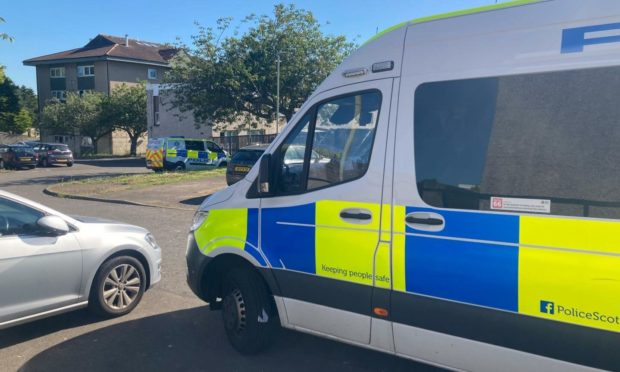 Two police vehicles at Linfield Road in Mid Craigie, around 9.30am on Thursday.