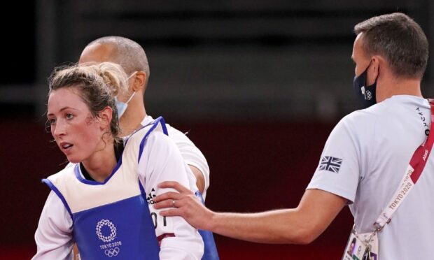 Great Britain's Jade Jones is comforted by members of her team after losing.  RESTRICTIONS: Use subject to restrictions. Editorial use only, no commercial use without prior consent from rights holder.