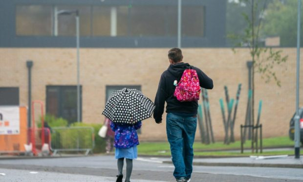 Calls have been made for all parents to be allowed on school grounds when dropping off younger pupils when the new school year begins next month.