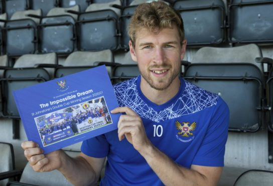 David Wotherspoon holds St Johnstone's cup double photo book.