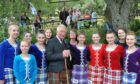 The Duke of Rothesay with Highland dancers at the 2019 Glenisla gathering.