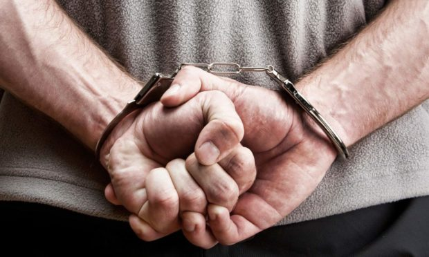Stock photo: Prisoner in handcuffs