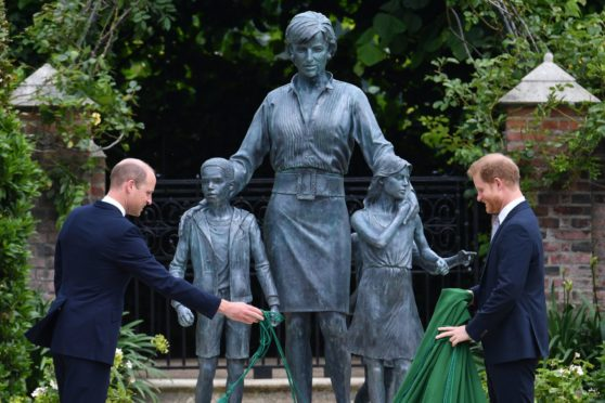 The Duke of Cambridge (left) and Duke of Sussex unveiling a statue they commissioned of their mother Diana, Princess of Wales, in the Sunken Garden at Kensington Palace, London, on what would have been her 60th birthday.