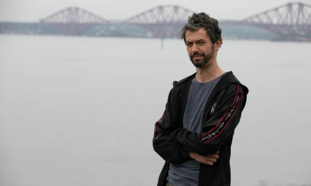 Graham Mitchell, 41, who helped rescue a 13-year-old girl from drowning in Dalgety Bay.