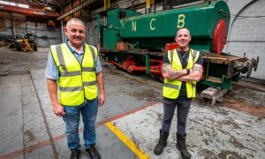 Mike Heron and Keith Brown with the Lochmore Meadows train they want to restore.