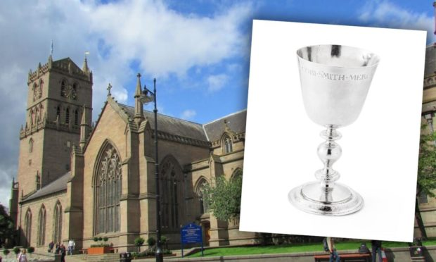 The Steeple Church and the cup up for auction next month.