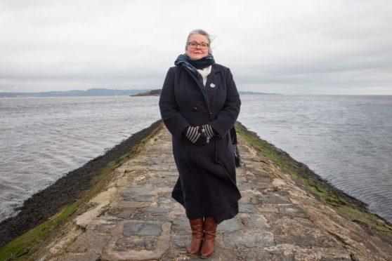 Gillian Barclay on a pier near open water