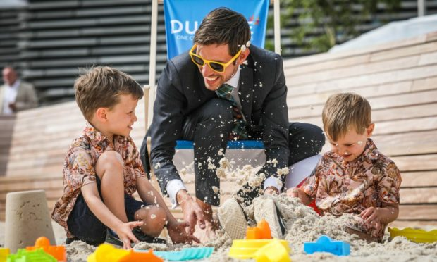 Dundee City Council leader John Alexander playing in the sand at the newly opened urban beach with his kids Jack, 5, and Noah, 4.