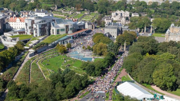 Global Climate Strike protesters pass the Scottish Parliament in 2019.