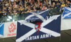 Scottish supporters with flags in the stands of the National Stadium in Warsaw.