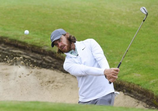 Tommy Fleetwood practices out of a green side bunker on the 6th hole at Sandwich.
