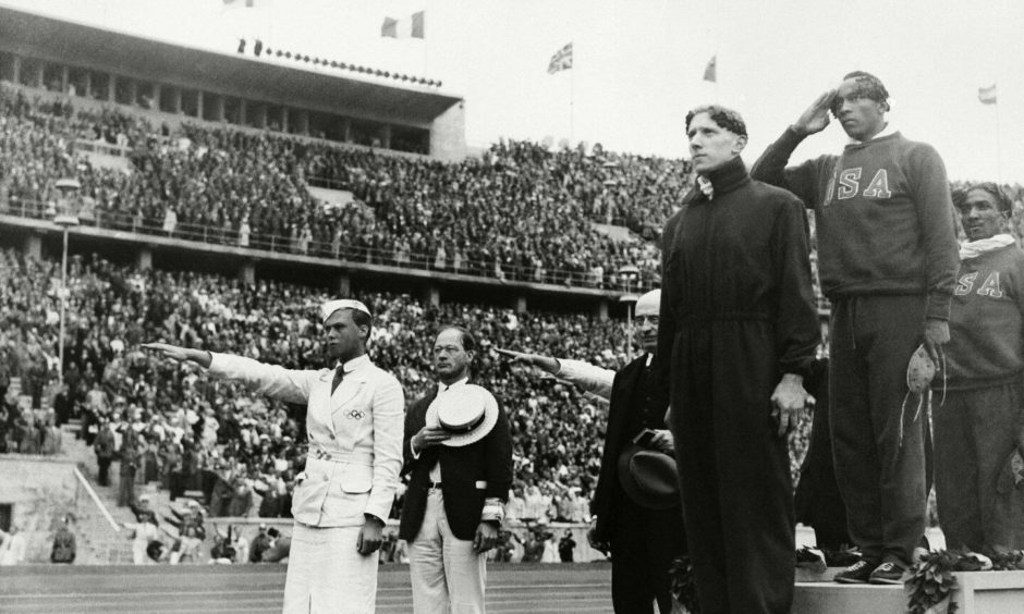 Lawson Robertson was head coach of the US Olympic team when Jesse Owens, middle, won four gold medals in Berlin in 1936.