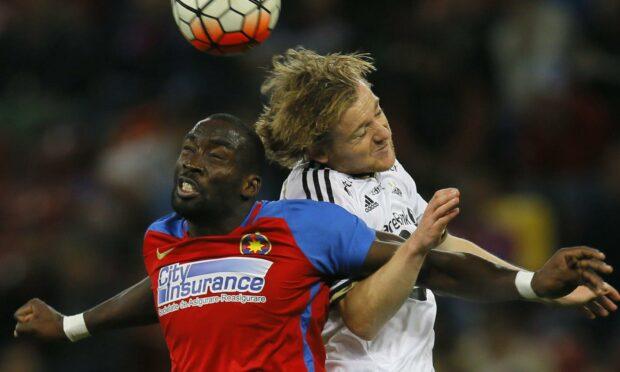 Tade starring for Romanian giants Steaua