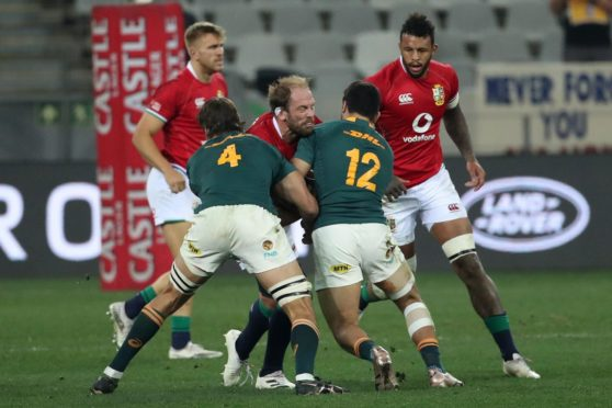 Lions captain Alun-Wyn Jones is double tackled as he tries to carry.