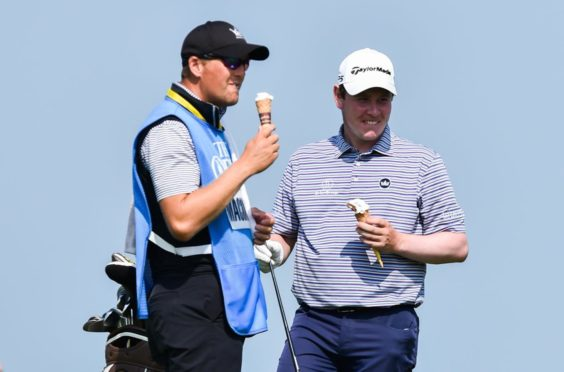 Robert MacIntyre and his caddie Mike Thomson find time for a 99 at Royal St George's.