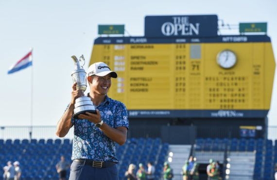 Collin Morikawa holds the Claret Jug after winning the 149th Open Championship at Royal St George's.