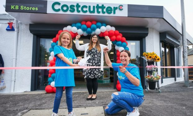 Madison Martin, 9, with shop owner Anila Anwar and mum Samantha Kirk, at the grand-opening of the newly refurbished Costcutter store in St Andrews.