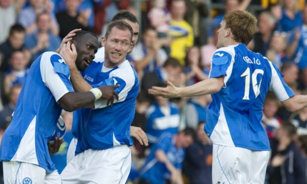 Liam Craig celebrates with Gregory Tade after his goal against Eskisehirspor in 2012.