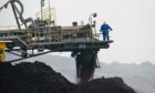 A bucket chain excavator mines lignite in the open-cast mine of Vattenfall AG in Jaenschwalde, Germany