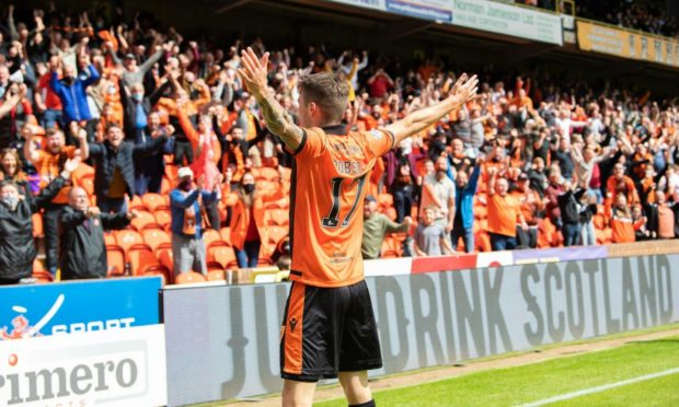 Dundee United left-back Jamie Robson celebrates after netting the winner against Rangers.
