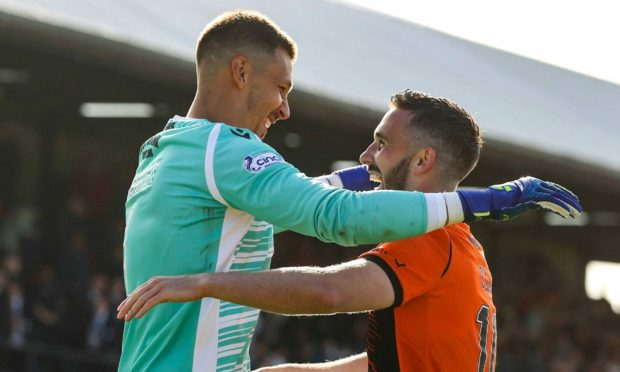 Dundee United goalkeeper Benjamin Siegrist and Nicky Clark were the penalty shoot-out heroes.
