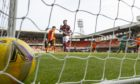 Armand Gnanduillet nets Hearts second goal to clinch their win at Dundee United