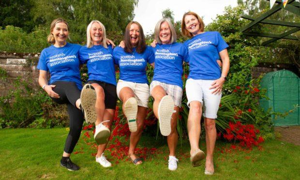 Claire Dyce, Gill Ferguson, Jennifer Paton, Dianne Scott and Susan Dyce celebrate their Three Peaks success. Pic: Paul Reid