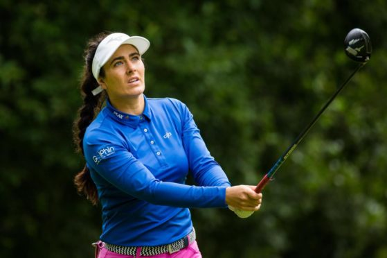 Kelsey MacDonald ground her way to a 71 to lie in the top five at the WSO.