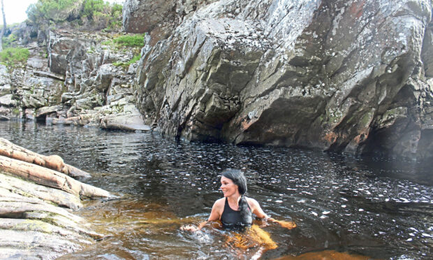 Gayle Ritchie enjoys a wild swim in a natural pool at Alladale Wilderness Reserve in Sutherland.