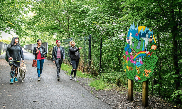 Gayle Ritchie with Whimsical Lush artist Suzanne Scott and students Lesley Rogers and Morgan McLaren walking the  new Monifieth Art Trail.