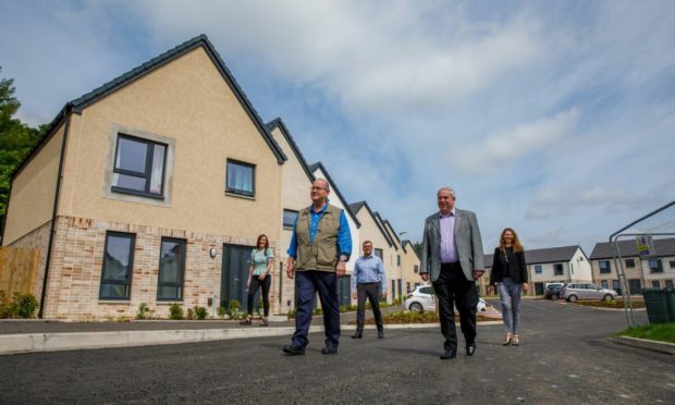 New council houses completed in Scone. From left: Elaine Ritchie, Bob Brawn, John Baggley, Chris Ahern and Nicola Lennon.